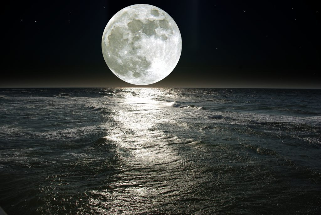 Silver full moon rise over the sea