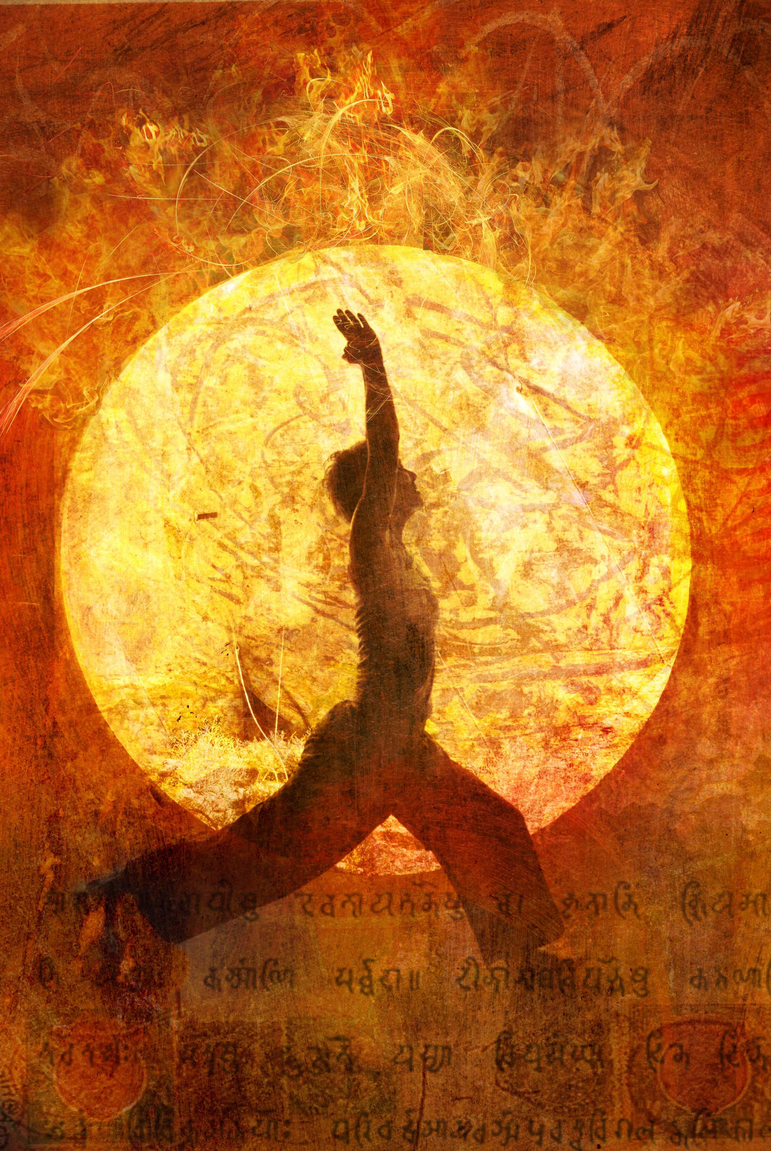 Yoga warrior in front of sun