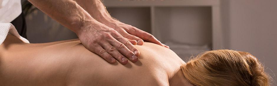 Swedish massage on womans back