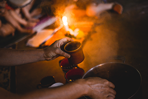Cup of Cacao and Fire in a Cacao Ceremony